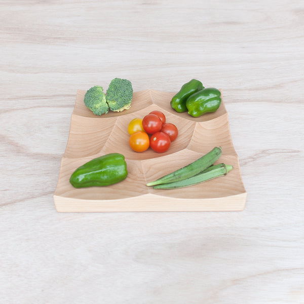 Storm Tray is carved from solid beech wood is perfect as vegetable platter solution