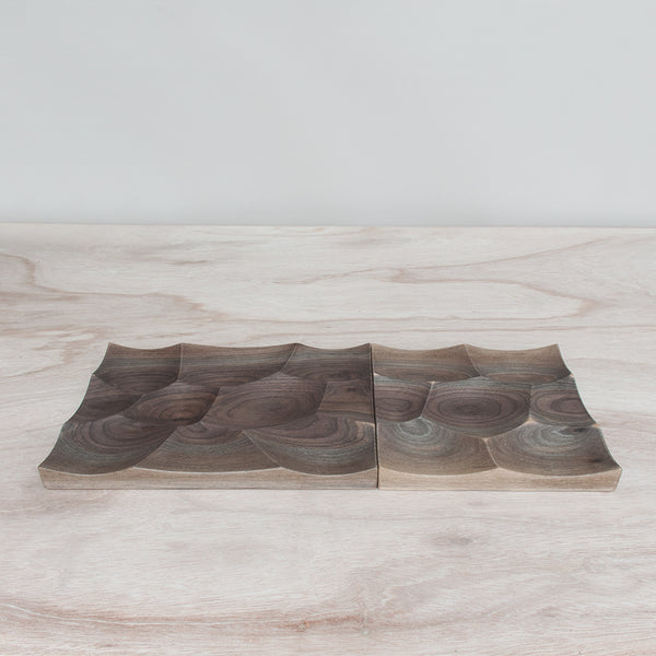 Storm Tray in walnut wood comes in two sizes large and small and could be tiled infinitely to create a wavy landscape
