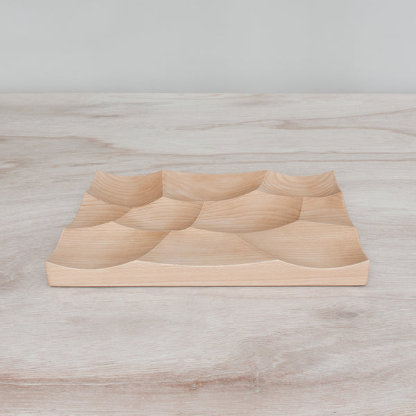 Storm tray is inspired by undulating ocean surface and made by 24d-studio