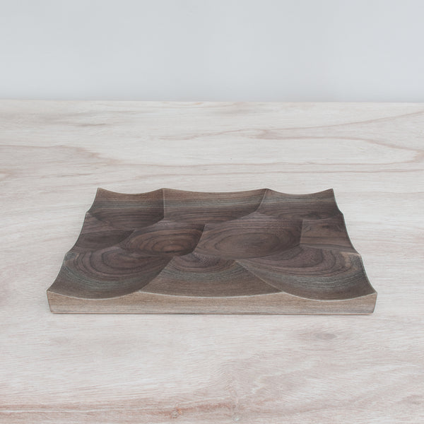 Storm is a sculptural tray inspired by the waves of the ocean and made from american walnut.
