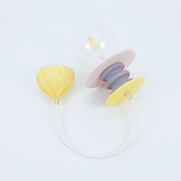 Frutti pendant lamp comes with white fabric cord, brass cord grip and bright yellow ceiling cap