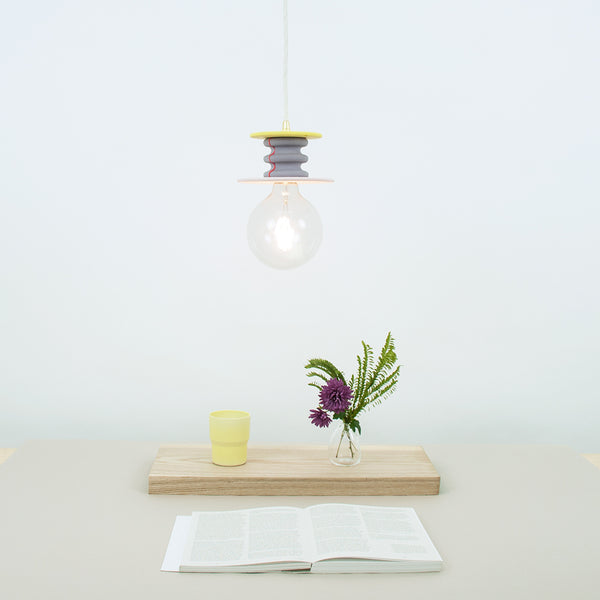 purple and yellow pendant lamp composed of various size color disks and ribbed cylinder in between, made by 24d-studio