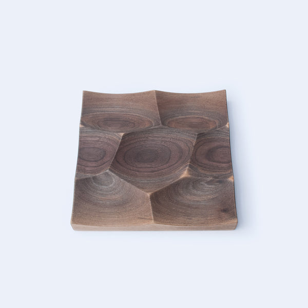 Storm Trays are made in two sizes and a variety of hardwoods as walnut and beech wood.