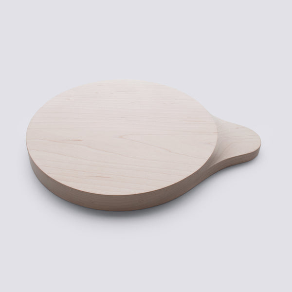 small round cutting board with the handle from hard maple wood made by 24d-studio