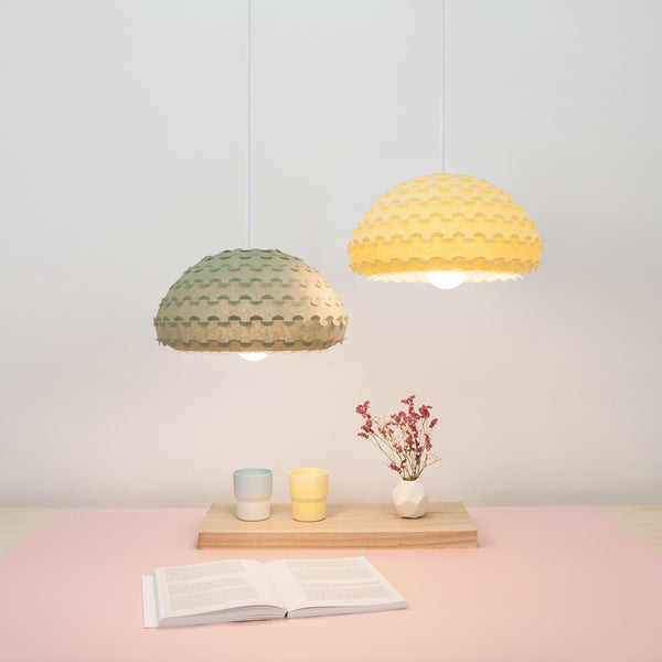 yellow and green pendant lamps from laminated rice paper