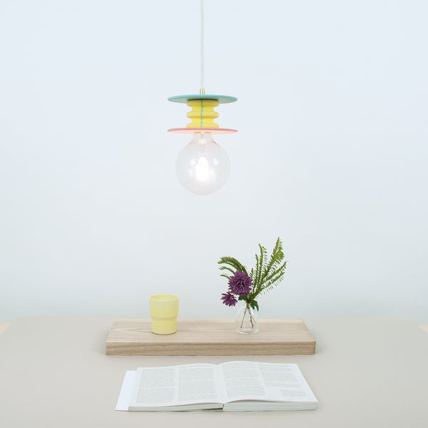 playful and bright pendant lamp composed of various size color disks and ribbed cylinder in between, made by 24d-studio