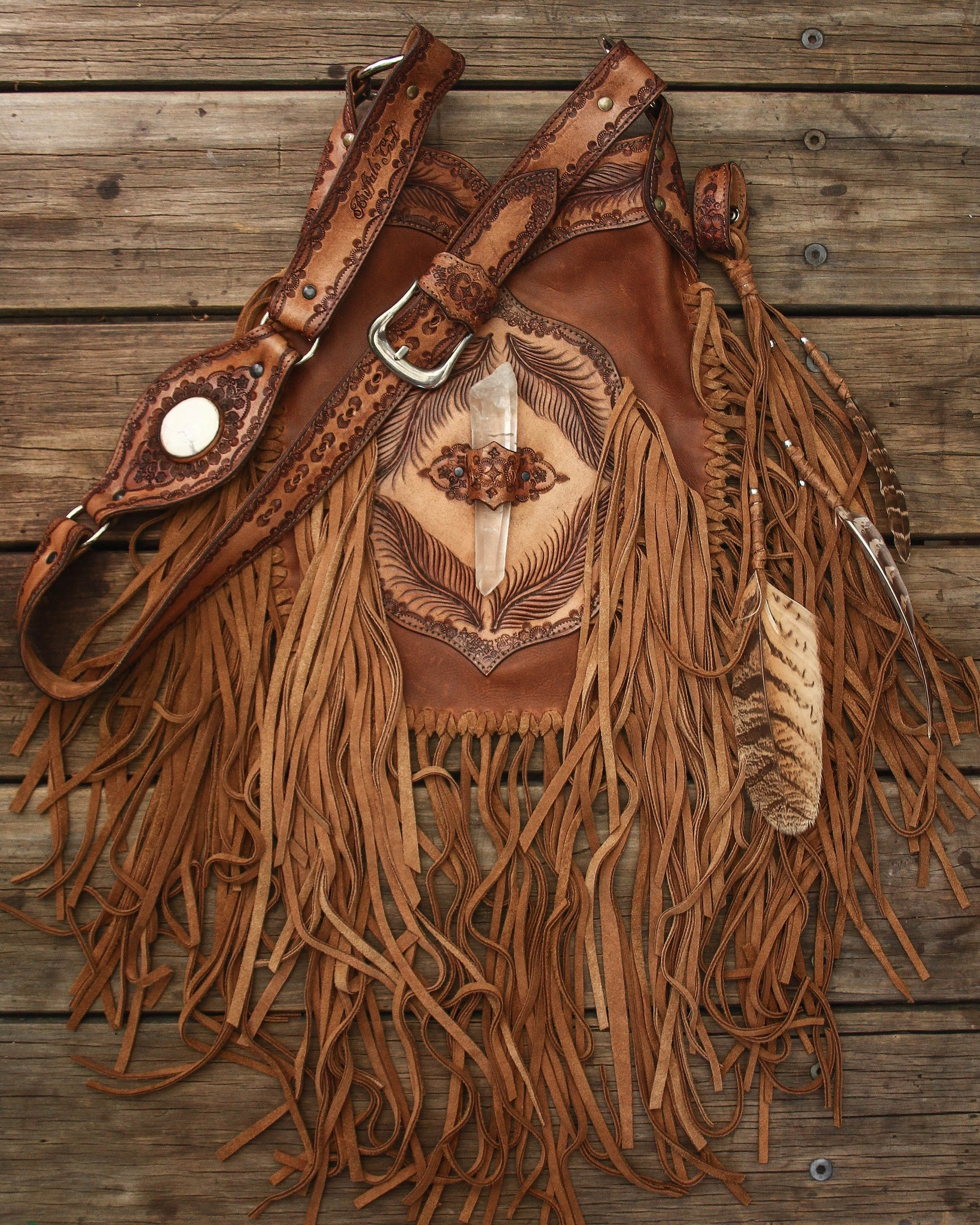 Apache Tasseled Bag with Quartz Crystal in distressed tan leather with suede tassels.