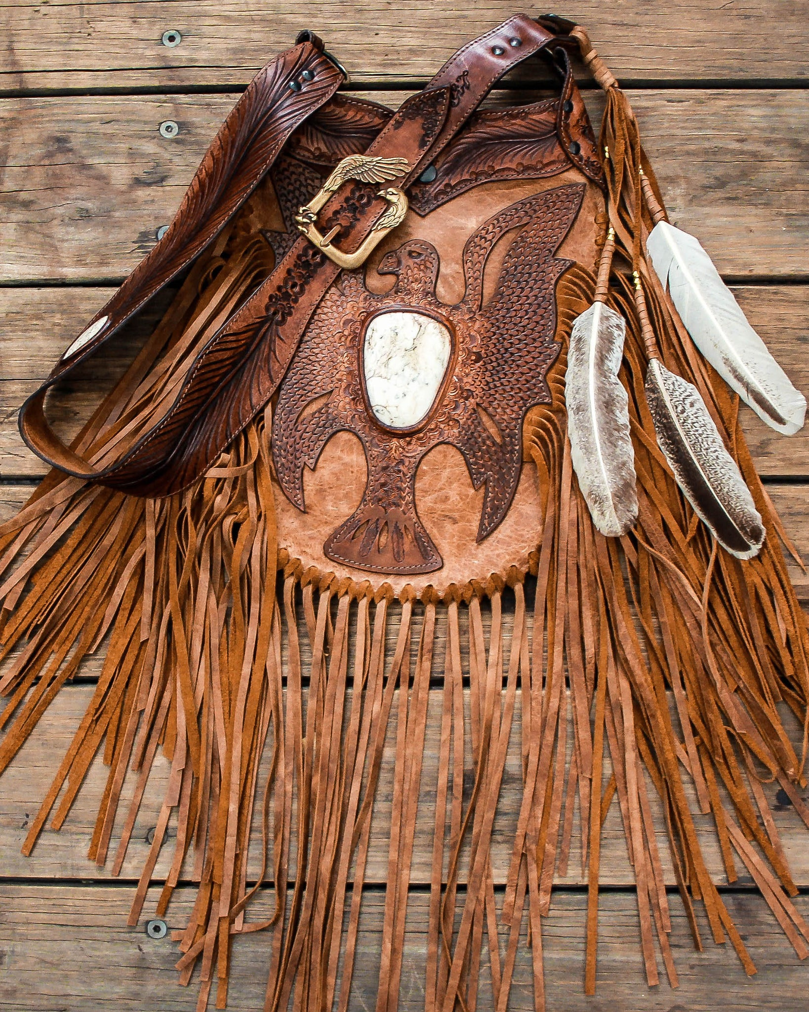Apache Eagle Tasseled Bag with Howlite in distressed tan leather.
