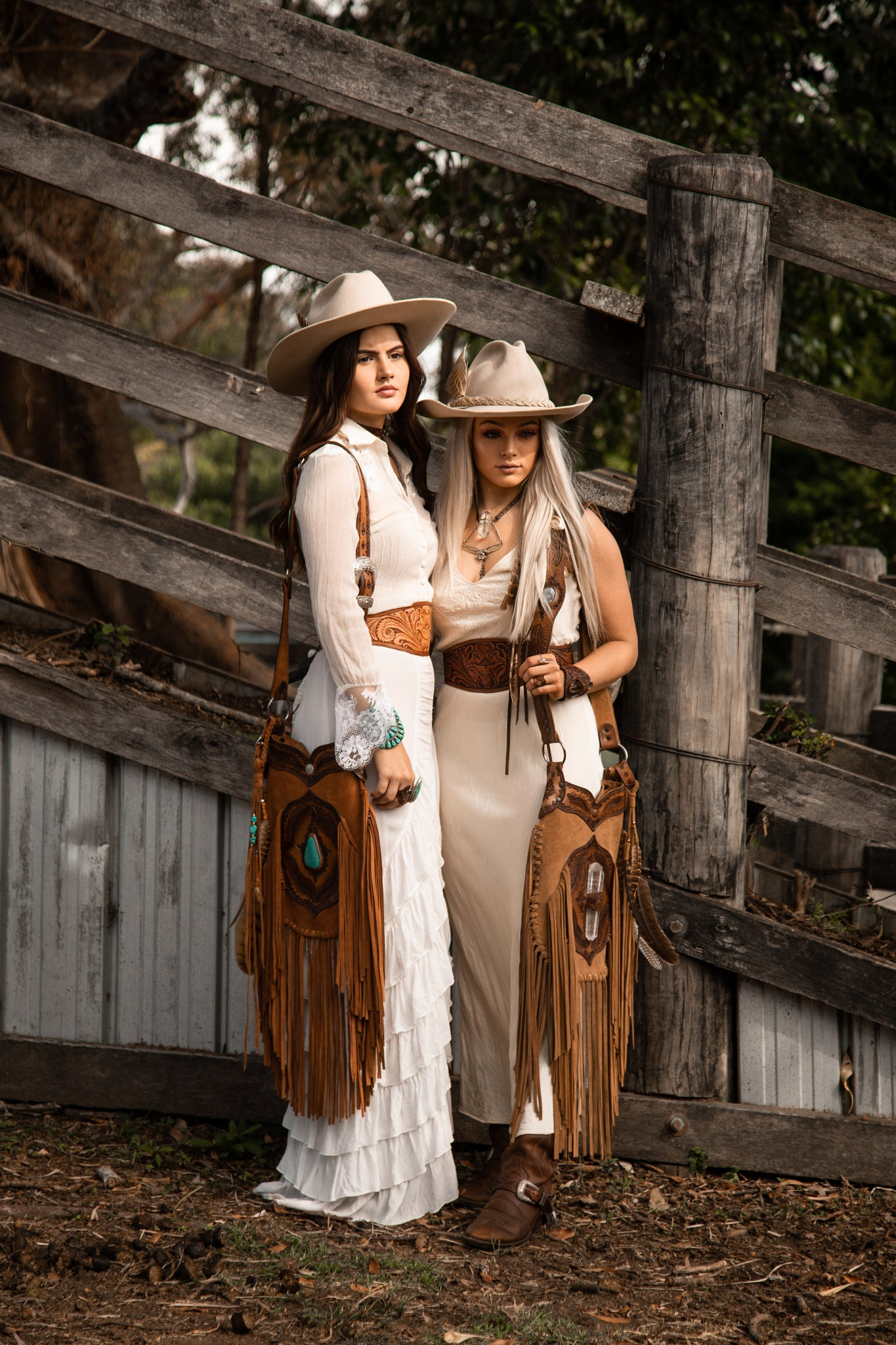 Cowgirls wearing Buffalo Girl Apache Tasseled Bags with Turquoise and Quartz Crystal, both in gorgeous soft suede.