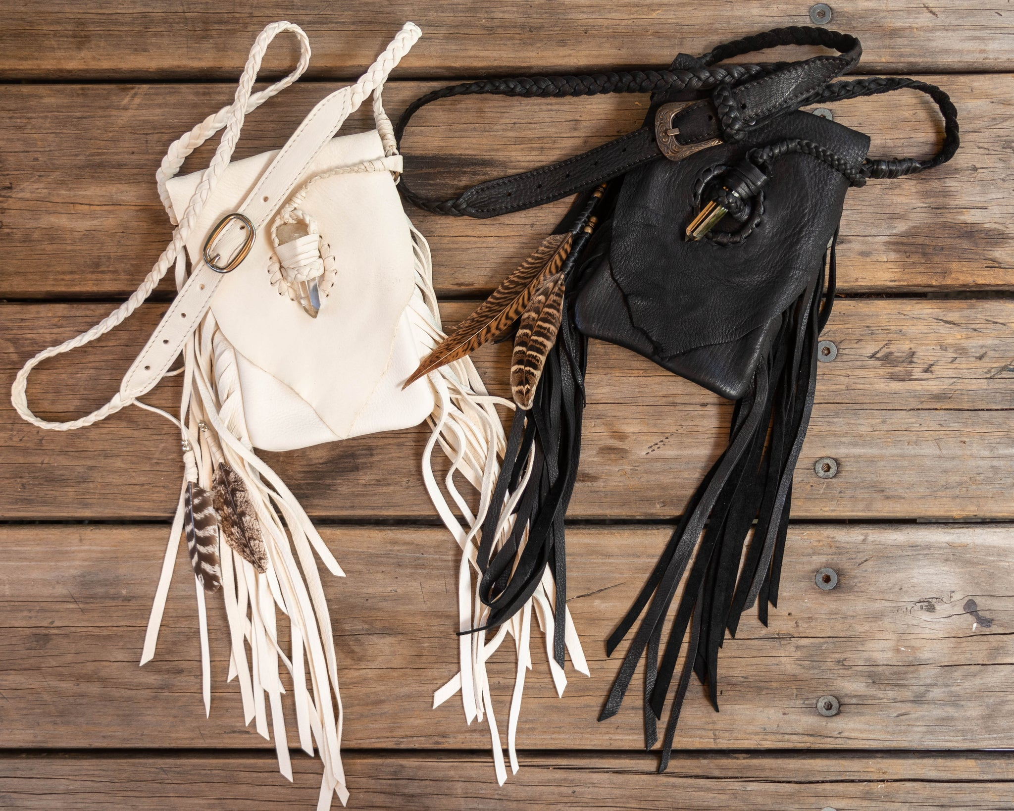 Custom made phone pouches made out of white and black deer hide featuring handpicked crystals & plaited straps  - $650