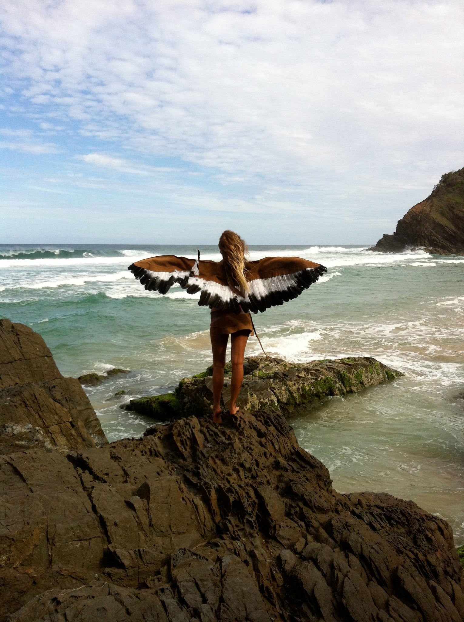 Girl wearing wings at Whites Beach