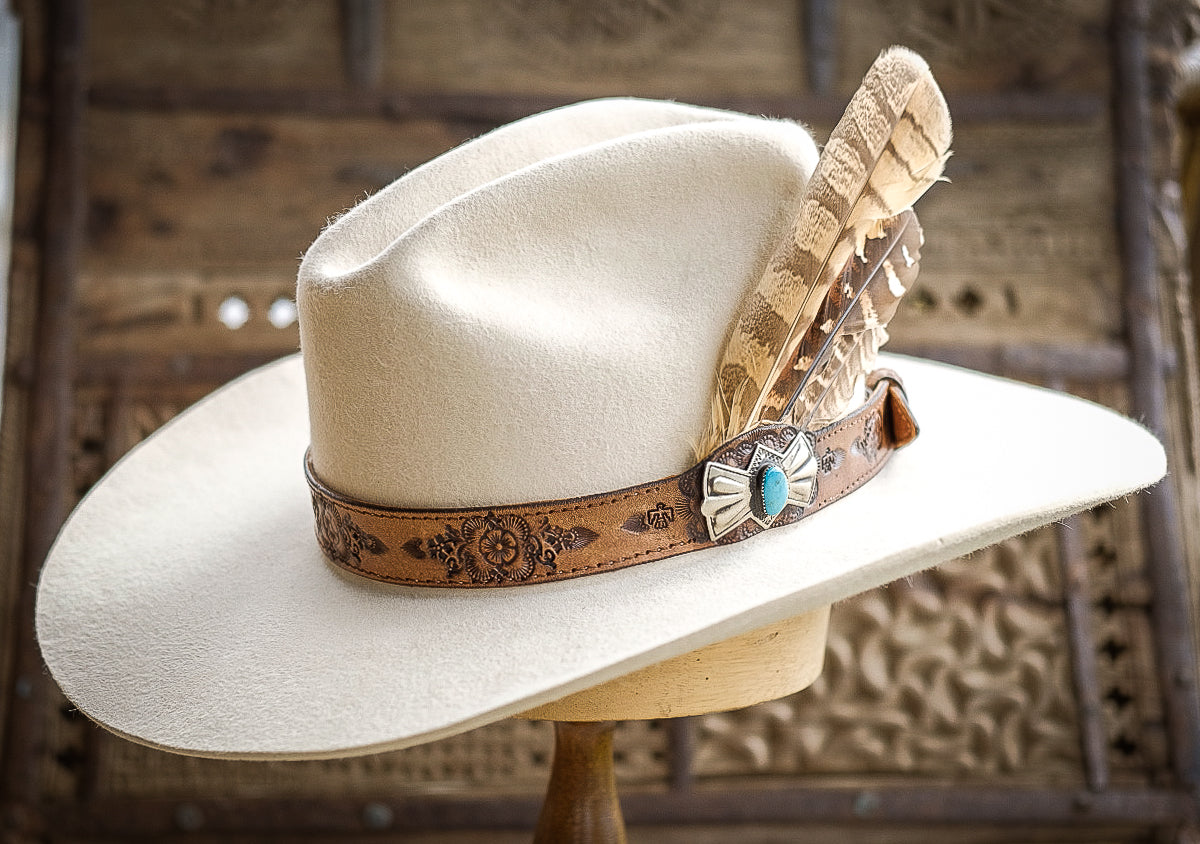 Hand tooled hat band with silver Navajo concho featuring a turquoise stone