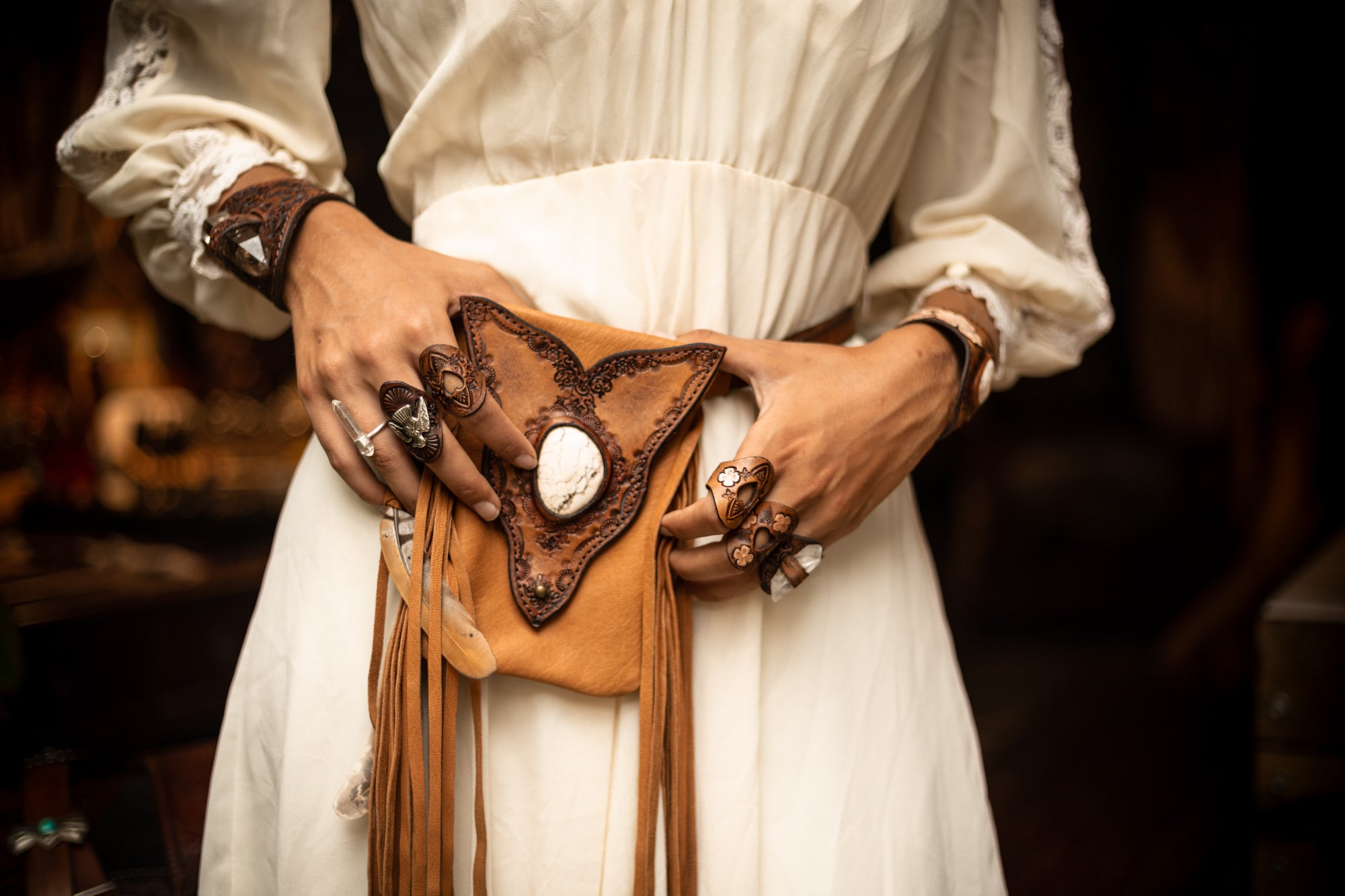 Gypsy Wanderer tasseled Phone Pouch with in soft tan leather featuring a white Howlite stone - $480