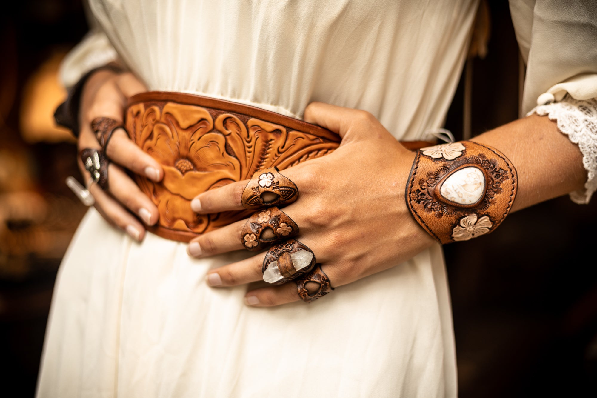 Buffalo Girl hand carved waist belt and tooled leather jewellery