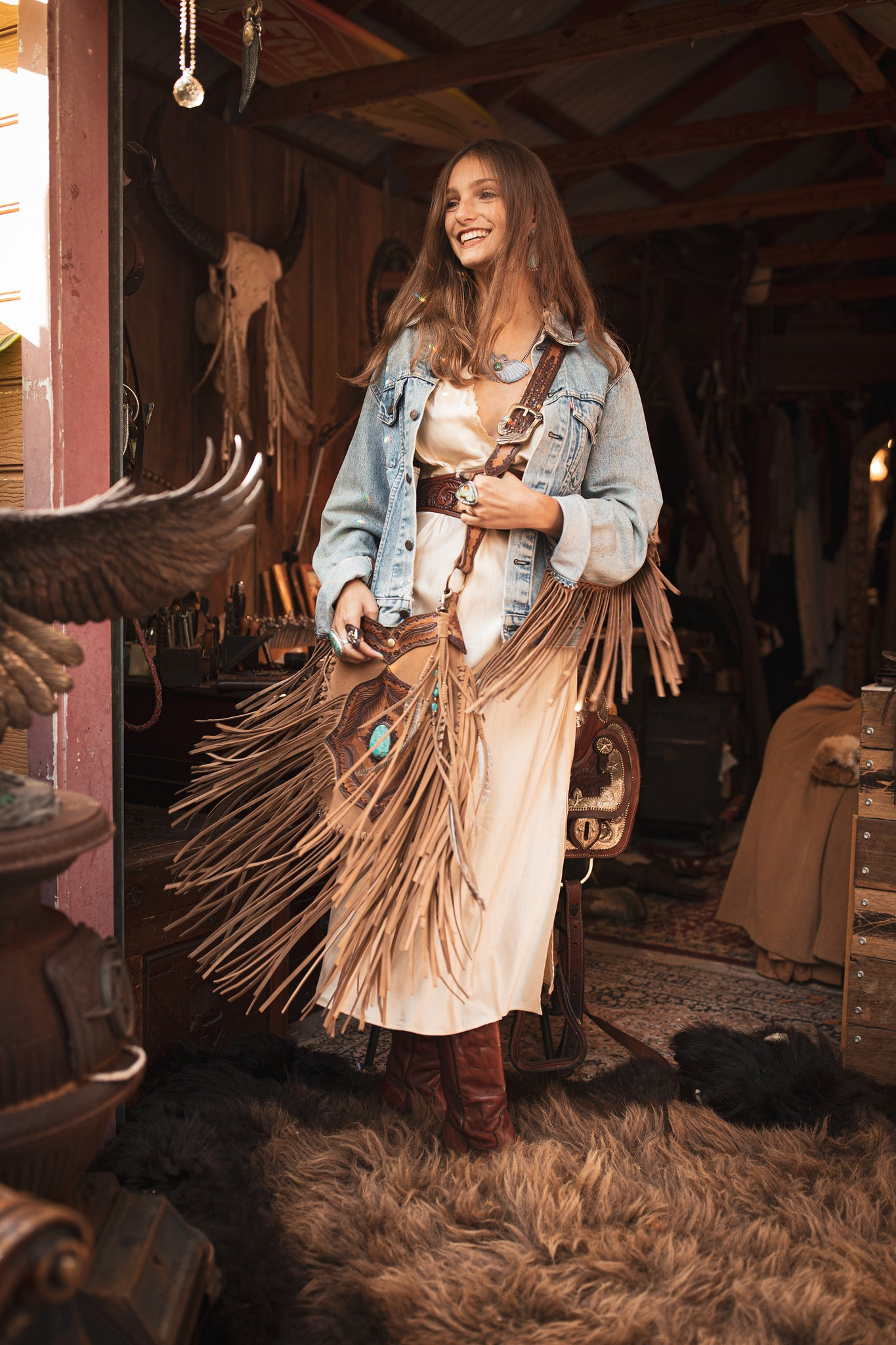 Twirling with Buffalo Girl Apache Tasseled Bag in tan suede featuring a beautiful Sierra Nevada Turquoise stone - $2400