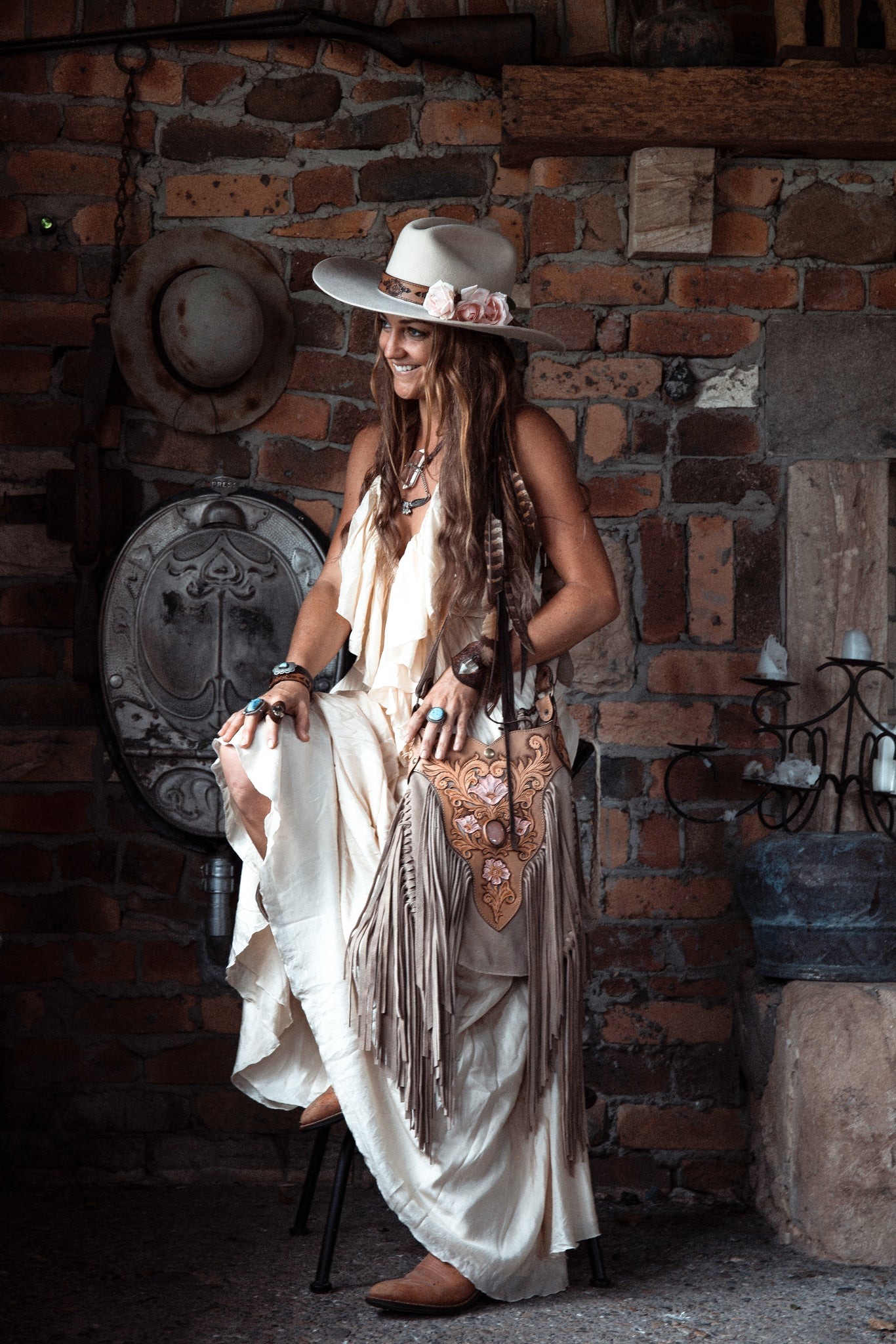 Dusty Mountain Bag in cream suede with long tassels and Rose Quartz stones - $2000