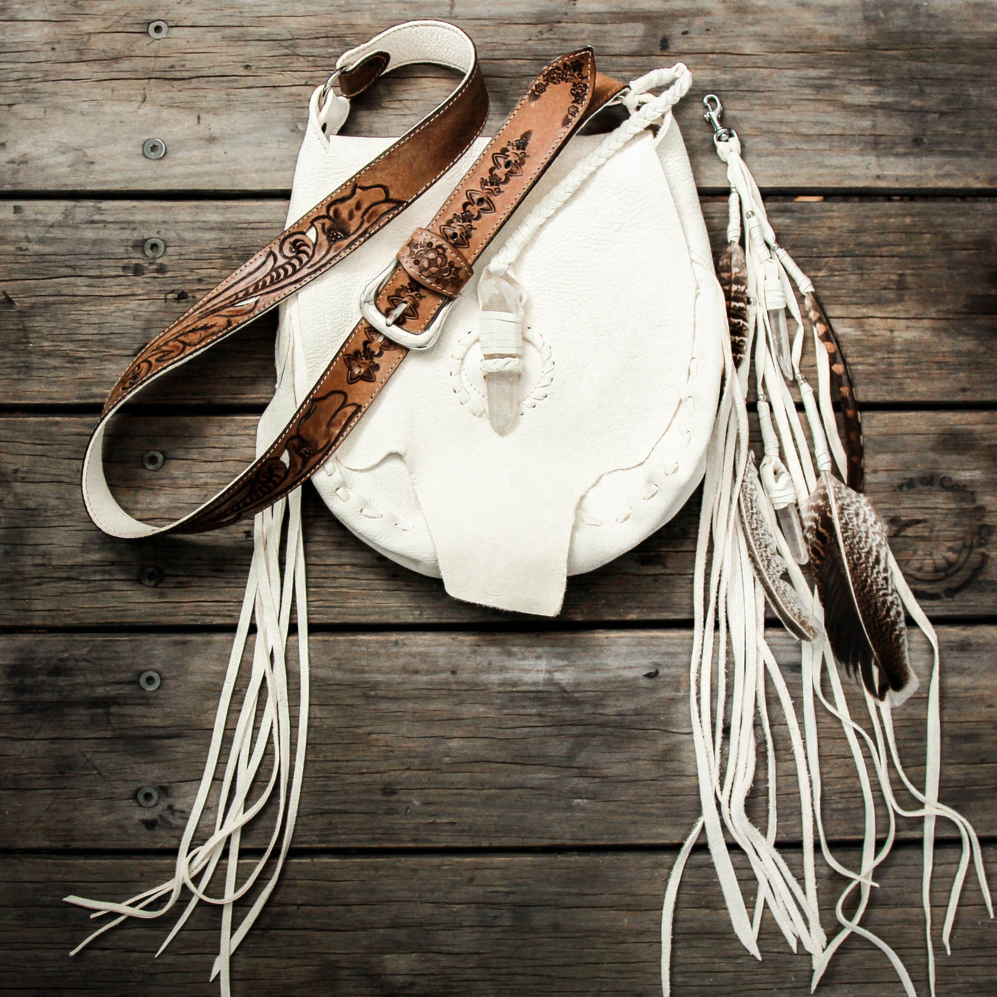 Raw Hyde Nomad Bag with Quartz Crystal fastening in white deerskin.