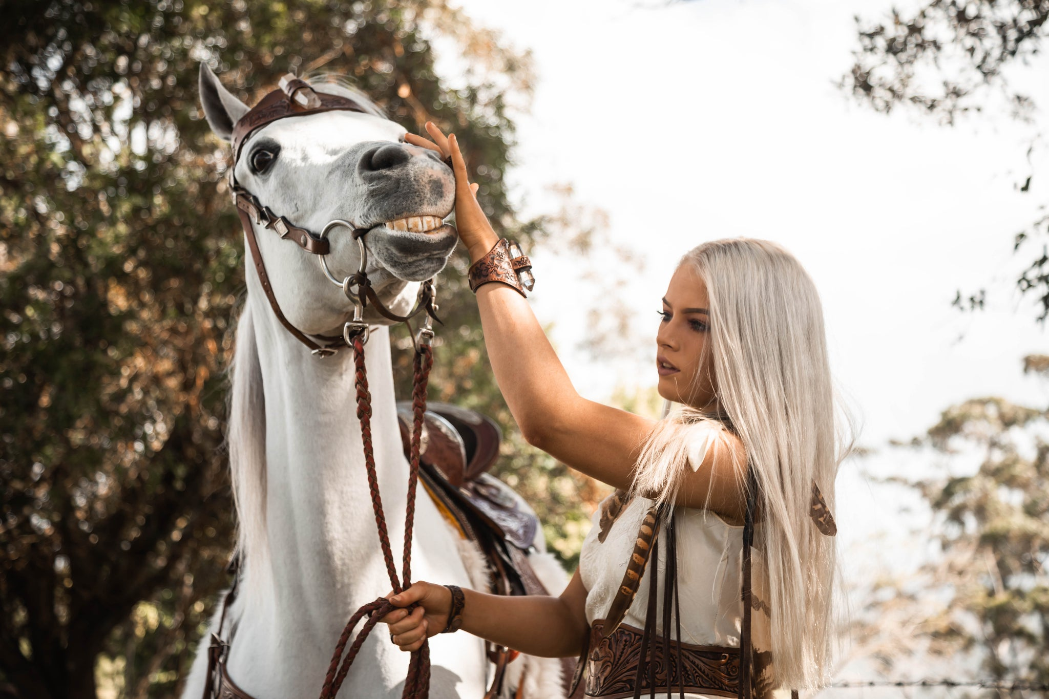 Blonde girl and white horse