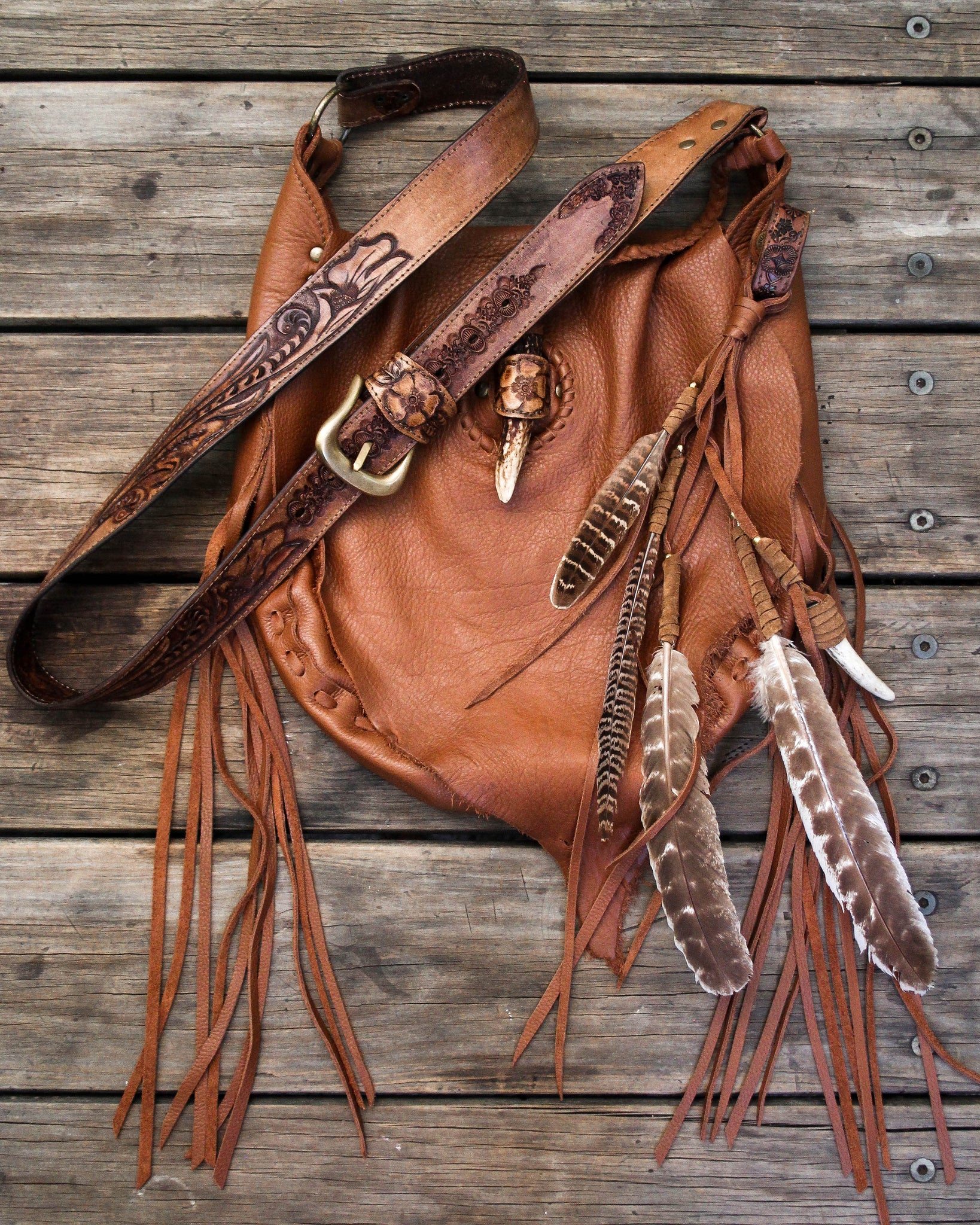 Raw Hyde Nomad Bag with Stag Horn Fastening in soft tan leather.