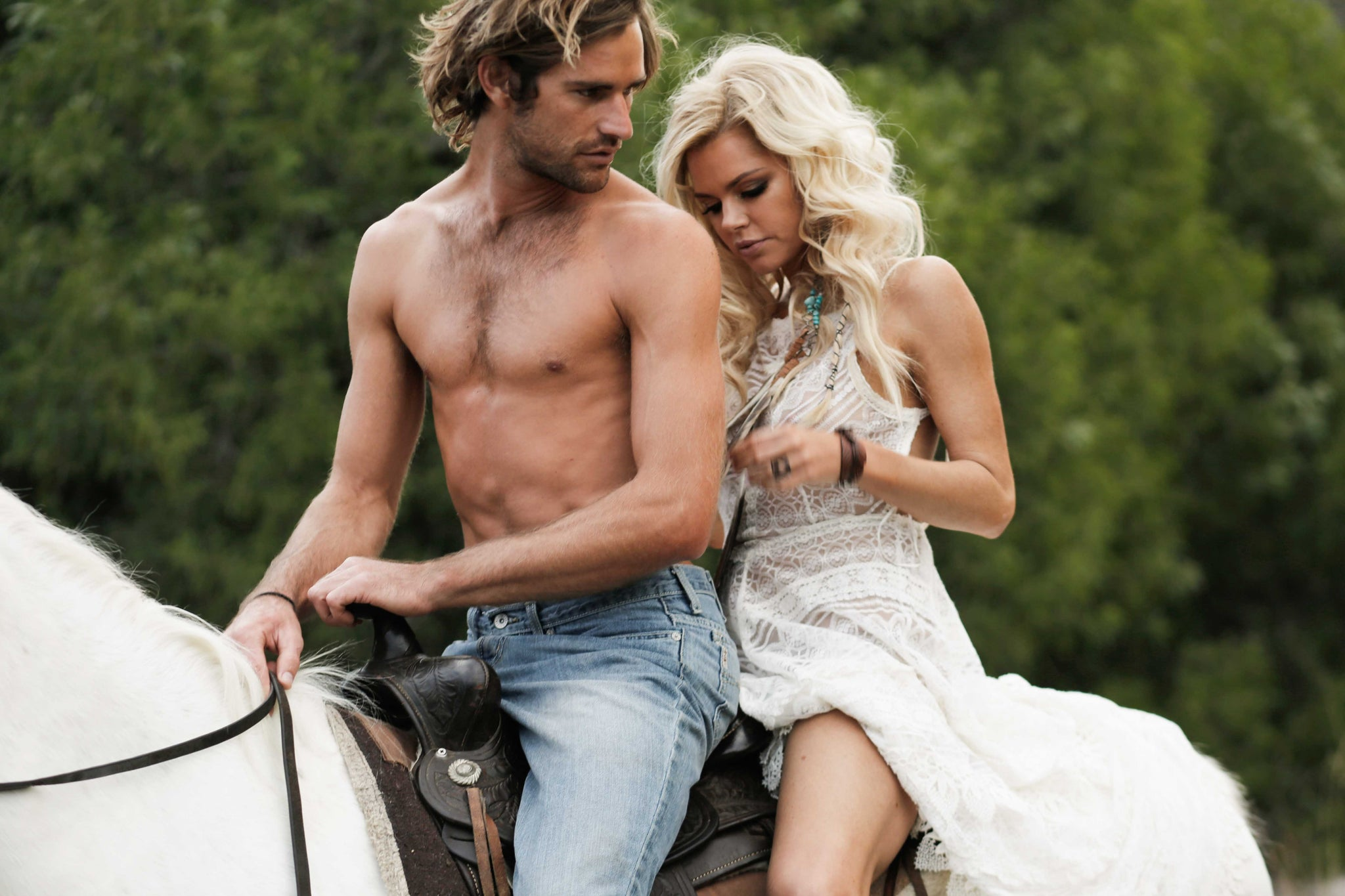 Sophie Monk on a horse with a hot guy