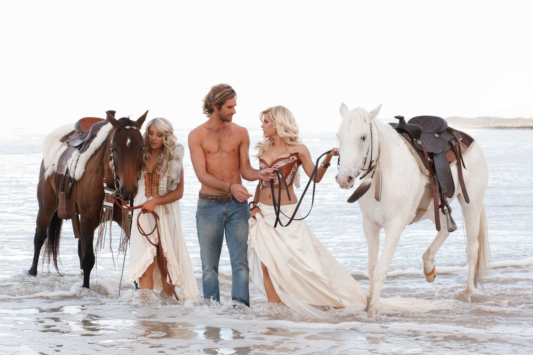 Sophie Monk on the beach with friends and horses