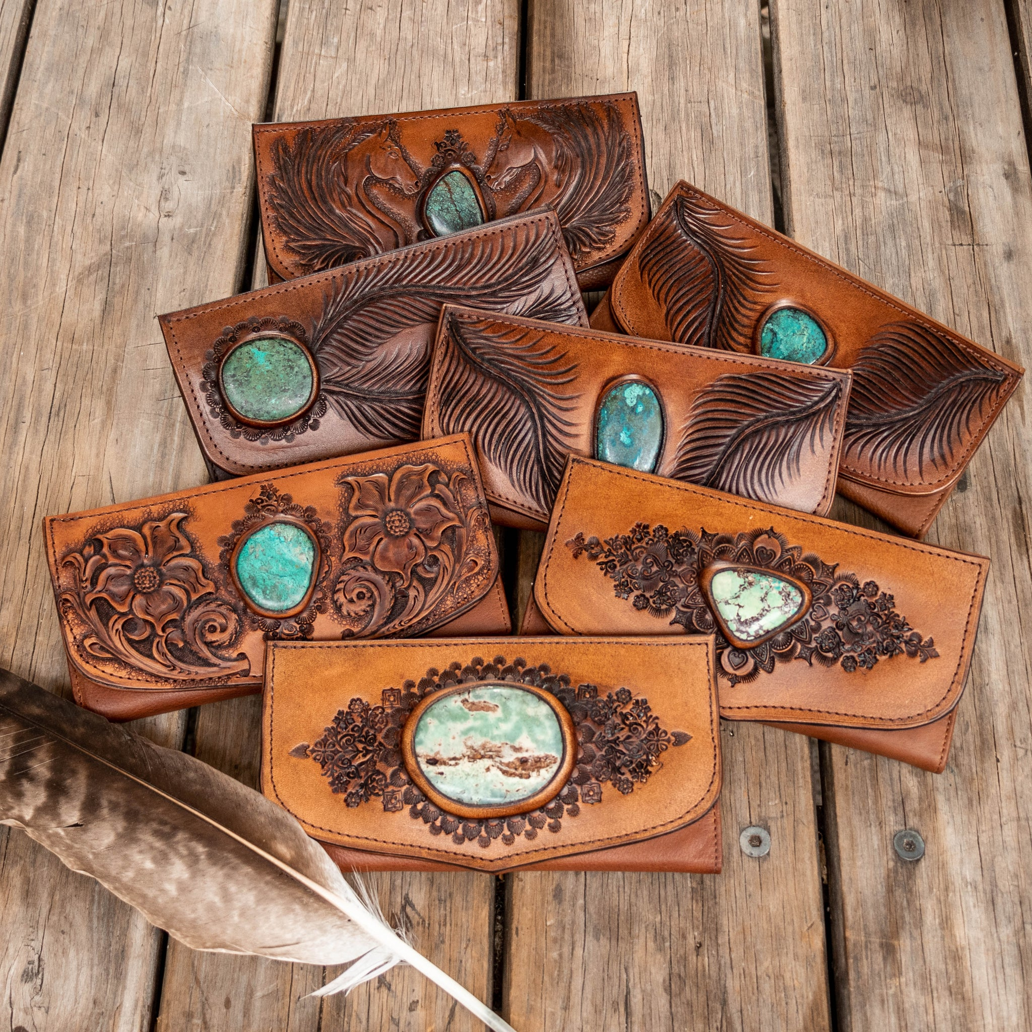 A selection of Buffalo Girl leather wallets with turquoise stones