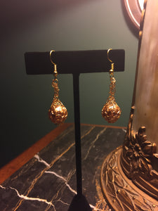 Golden wrapped pearl earrings