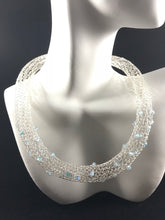 Silver crocheted wire necklace with frosted aqua Swarovski crystals