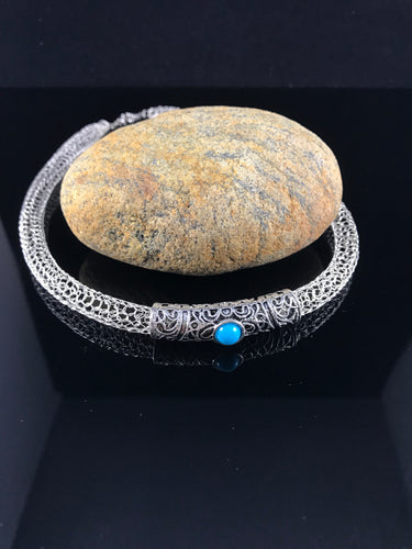 Silver necklace with turquoise charm crocheted from wire