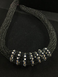 Black wire with silver foil beads necklace