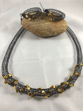 Black crocheted wire necklace and earrings with gold beads
