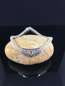Silver crocheted wire necklace with charm
