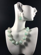 Silver crocheted wire pale green earring and necklace set