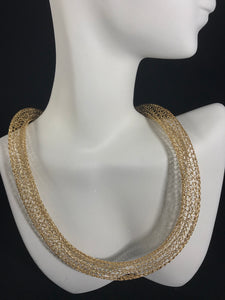Gold colored crocheted necklace