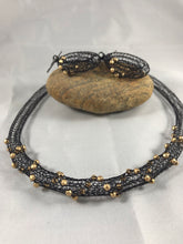 Black wire necklace and earrings with metallic gold beads