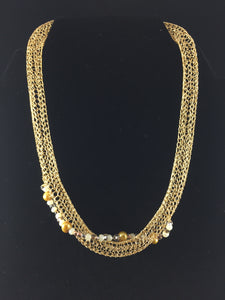 Gold crocheted necklace with crystals and beads