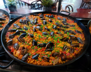 Valenciana/Provincial Paella – Diced boneless chicken + Spanish chorizo + tender calamari + local black mussels