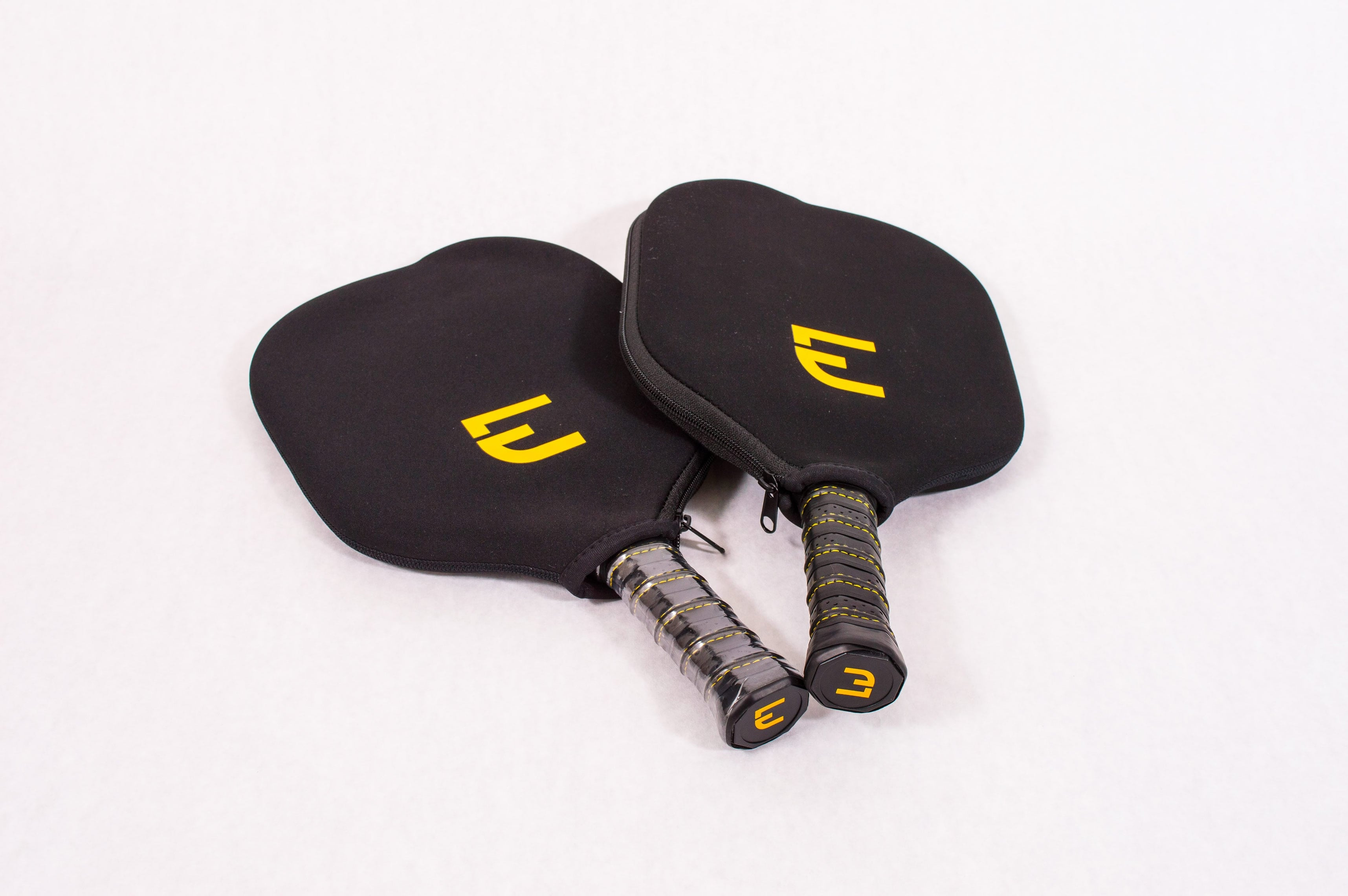 Two Electrum Pro Pickleball Paddles in Protective Electrum Covers
