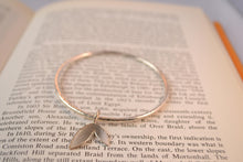 Silver bangle with double leaf charm