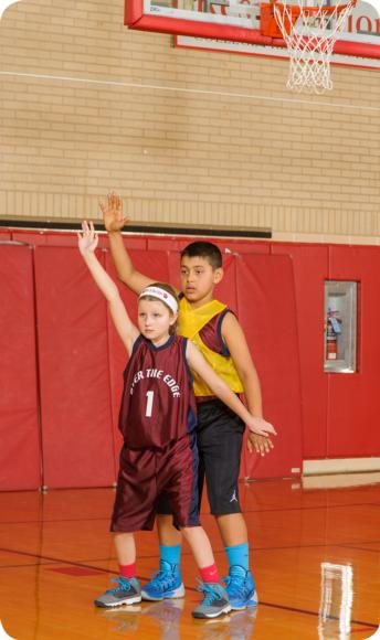 Defender fronting a low post with a size advantage.