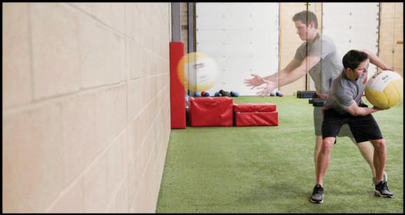 Figure 7.29 Medicine ball standing side-twist throw.