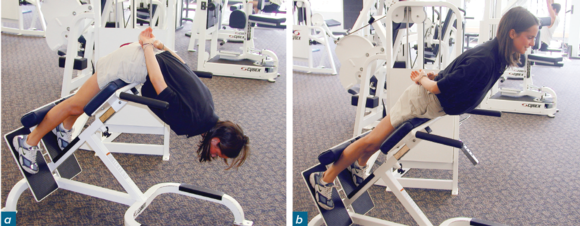 Figure 5.6 Incline back extension. Rise up so your upper back is in a straight line with your legs.