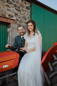 Glorious barn wedding surrounded by tractors, baby farm yard animals and a whole lot of grinning from ear to ear!