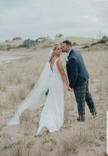 A stunning back drop for a gorgeous bride