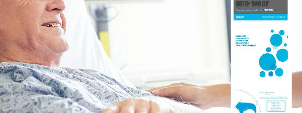Man wearing disposable briefs sitting in a hospital bed
