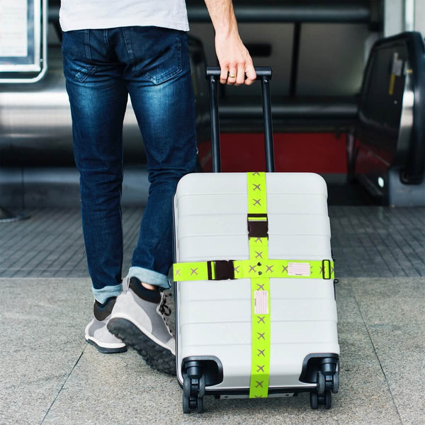 OW Travel Personalised Luggage Case Cross Straps for Suitcases and Luggage - Planes Yellow - Man Holding Suitcase with Cross Luggage Strap at the Airport