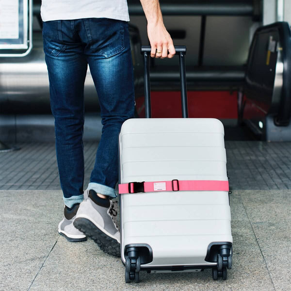 OW Travel Personalised Luggage Case Straps For Suitcases and Luggage Travel Accessories - Pink - Man Holding Suitcase with Luggage Strap at the Airport