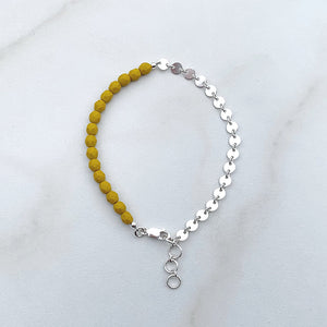 yellow beaded stacking bracelet with silver coin chain