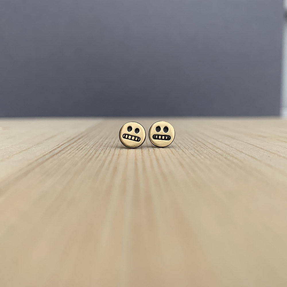 cringe face studs in brass