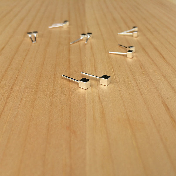 group photo of cube studs in sterling silver